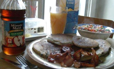 Pancakes, maple syrup, bacon, fruit loops, orange juice, milk, yum yum yum.